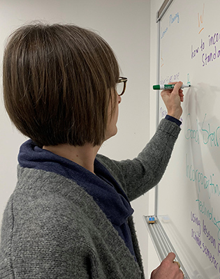 Instructor writing on a board